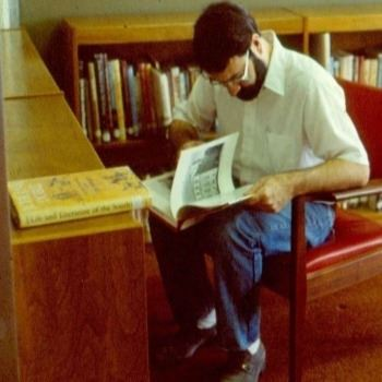 A Patron Enjoying a Book in the Newly Opened Library (1987)