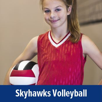 Skyhawks Volleyball. Caucasian girl holding a volleyball.