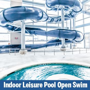 Indoor Open Swim. Indoor pool and blue slide pictured,