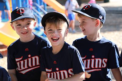Three happy T-ball players