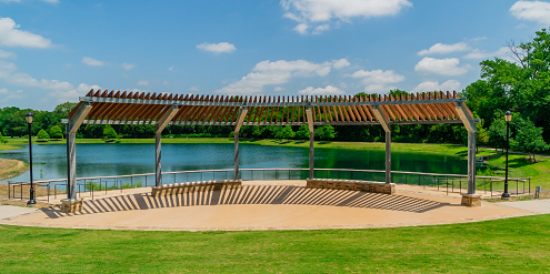 Open Amphitheater with pond in the background and grass in the foreground