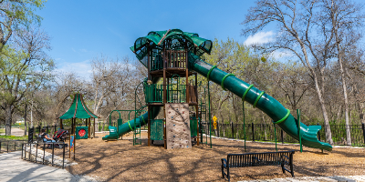 Huge play structure with two slides and a climbing wall