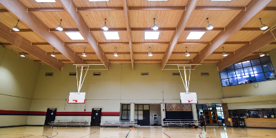 Large gymnasium with two baskeball hoops