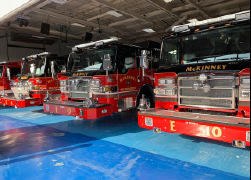 Three firetrucks parked in a row